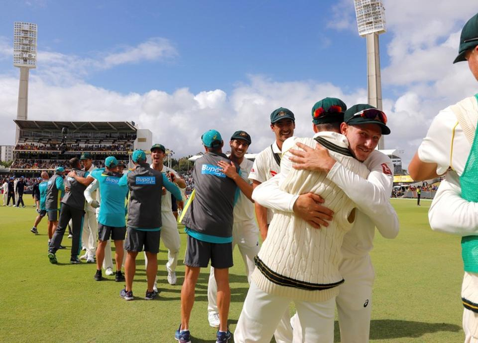 Australia cricket team players celebrate as as they walk off the ground after beating England cricket team in the third Ashes Test in Perth on Monday.