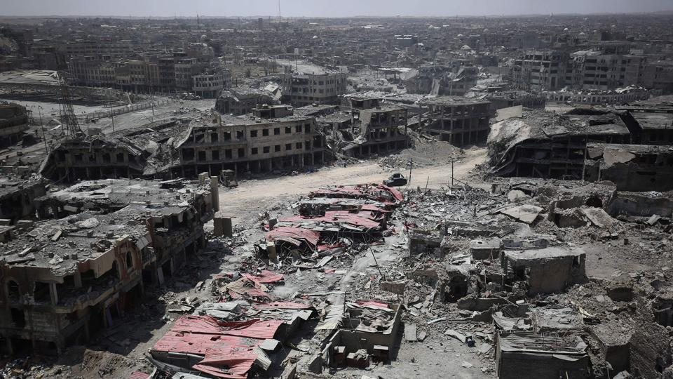 This file photo taken on July 09, 2017 shows a general view of the destruction in Mosul's Old City. 2017 will be remembered as the year the Islamic State organisation's ultra-violent experiment in statehood was terminated but Iraq and Syria are left staring at ruined cities and daunting challenges.  War-torn Syria remains the most dangerous country in the world for journalists.