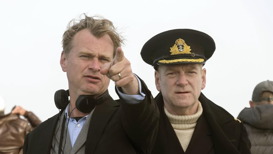 This image released by Warner Bros. Pictures shows director Christopher Nolan, left, on the set of Dunkirk with actor Kenneth Branagh.