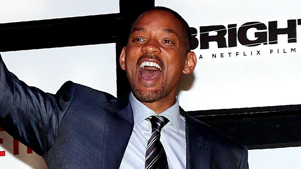 Will Smith gestures as he attends the premier of his cop thriller movie Bright in Mumbai.