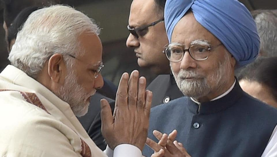 Prime Minister Narendra Modi greets former Prime Minister Manmohan Singh during a recent event.