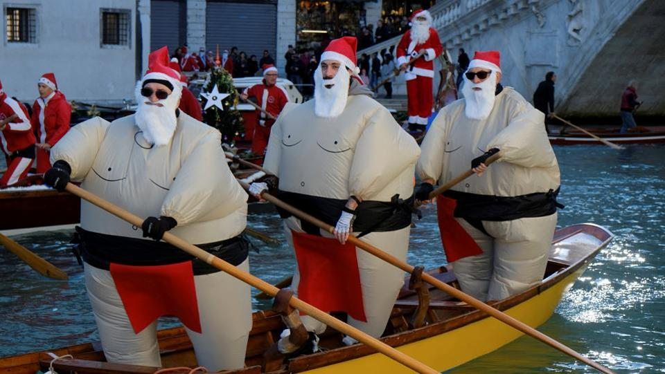 Not wanting to get his robes wet, Santa turned sumo wrestler during a Christmas regatta in Venice. (Manuel Silvestri / REUTERS)