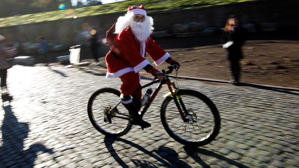 Santa brought out his newest ride as he joined hundreds of cyclists out on the streets of Rome, Italy. (Tony Gentile / REUTERS)