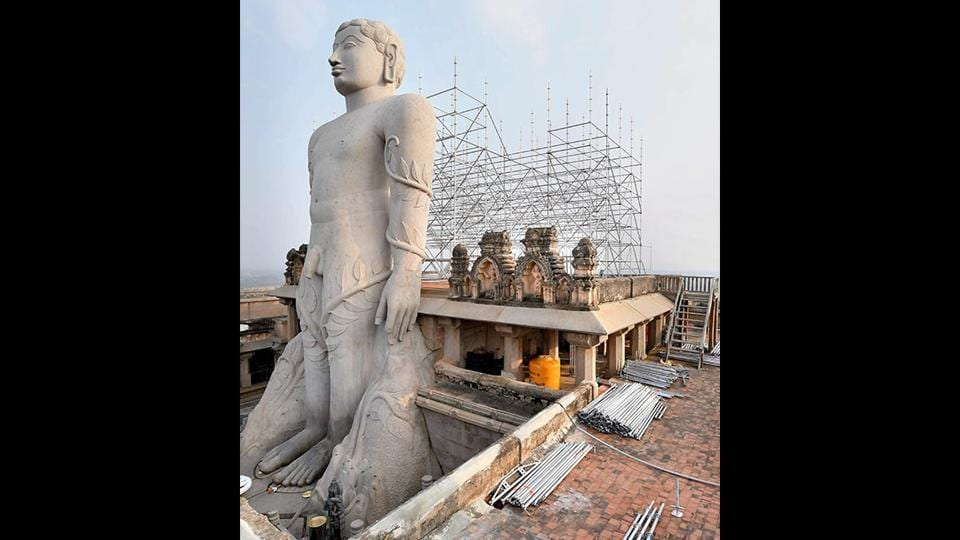 Scaffolding is being erected near the Gomateshwara statue ahead of the festival. The Public Works Department is constructing the structure using German ring-lock technology and a visitors' gallery at a cost of ₹11.25 crore. (PTI)