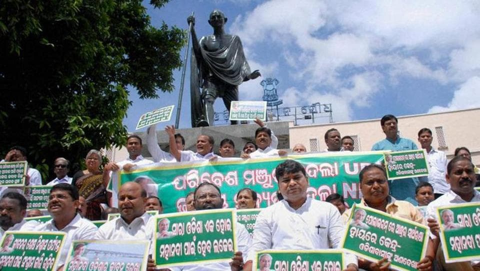 BJD MLAs sit on a dharna on the Mahanadi water issue on the state assembly premises in Bhubaneswar last year.