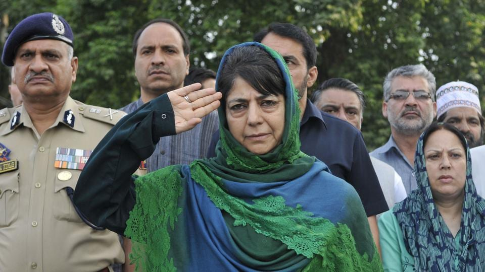 Jammu & Kashmir Chief Minister Mehbooba Mufti salutes during a ceremony marking Martyrs' Day at Mazar-e-Shuhada (Martyr's graveyard) in Srinagar. (Waseem Andrabi / HT Photo)