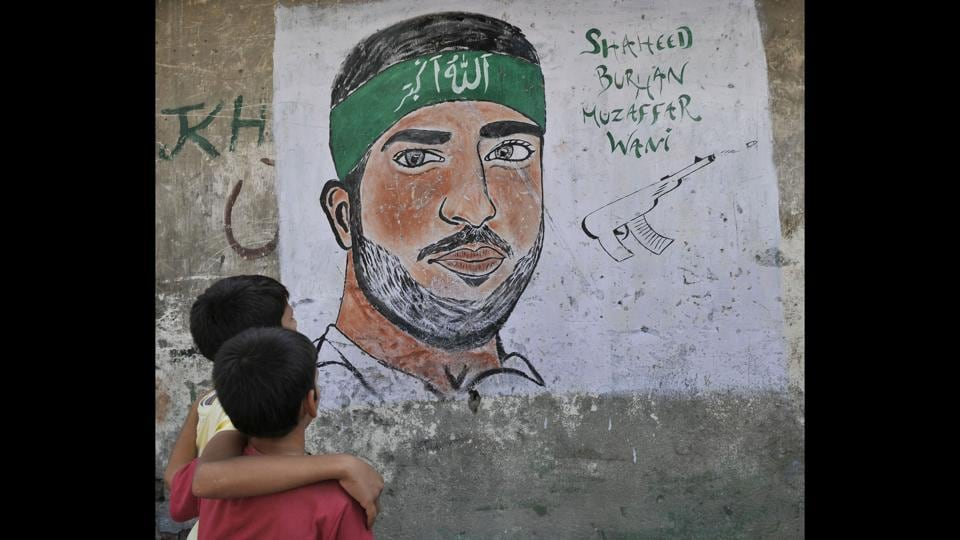 A month after Wani's killing, his face started appearing on walls as graffiti. Educated and media savvy, Wani powered a huge recruitment drive for the militant group through videos posted online, attracting similarly minded, young and educated youth to the decades-old fight for independence of the disputed region. (Waseem Andrabi / HT Photo)