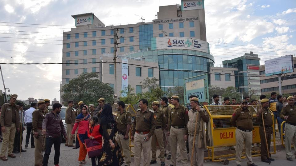 Police force outside Max Hospital in Shalimar Bagh, where a newborn baby was wrongly declared dead in New Delhi.