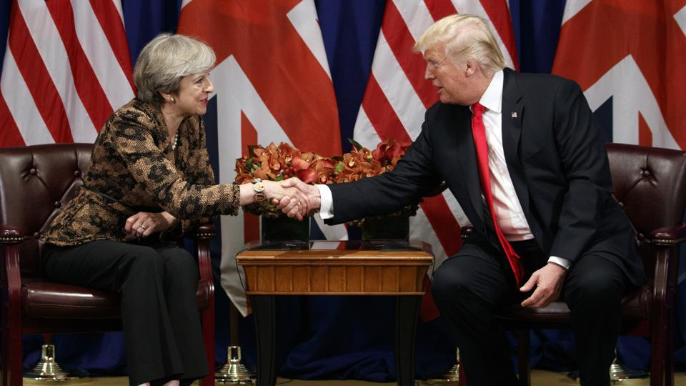 US President Donald Trump shakes hands with British Prime Minister Theresa May during their meeting at the Palace Hotel during the United Nations General Assembly in New York.