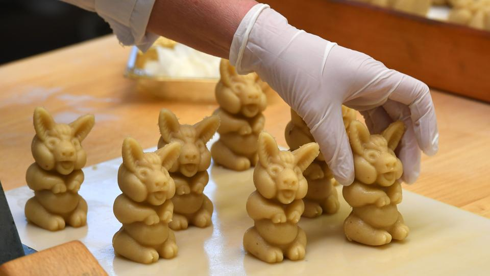 An employee is busy preparing pigs made of fresh marzipan at the headquarters of the traditional confectionary maker JG Niederegger GmbH in Luebeck.