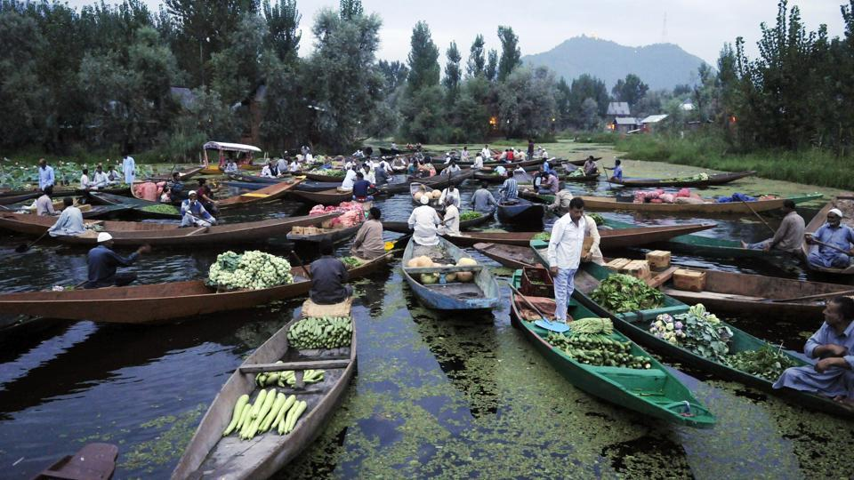 Kashmiri vendors display their wares at an early morning floating vegetable market on Dal Lake in Srinagar. In the ongoing Kashmir turmoil, during which most shops remained closed, the floating market functioned everyday and played an important role in providing vegetables to Srinagar residents. (Waseem Andrabi / HT Photo)