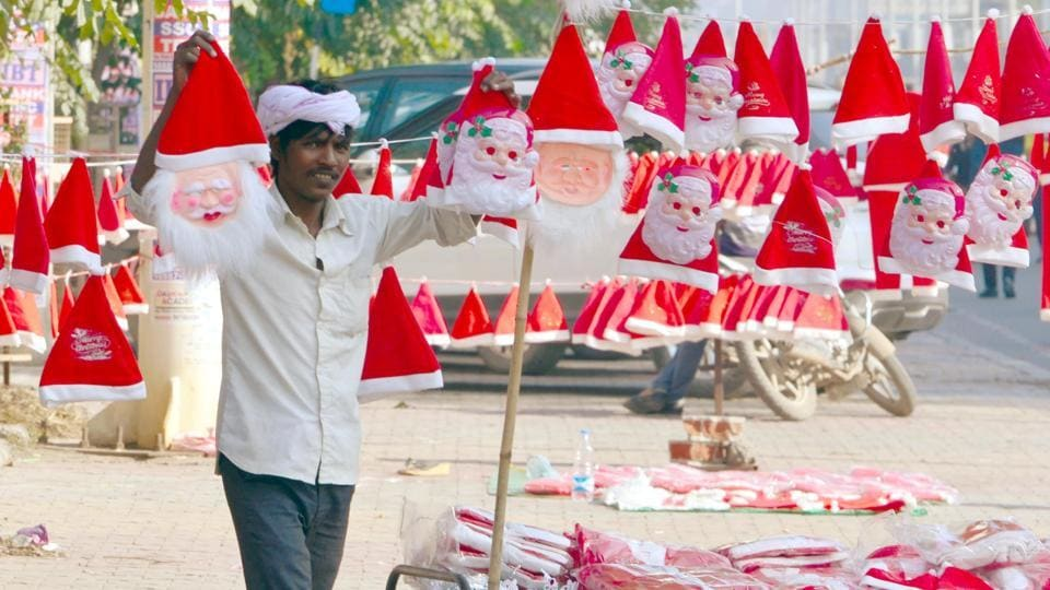 A roadside vendor sells Santa Claus masks ahead of Christmas in Amritsar.