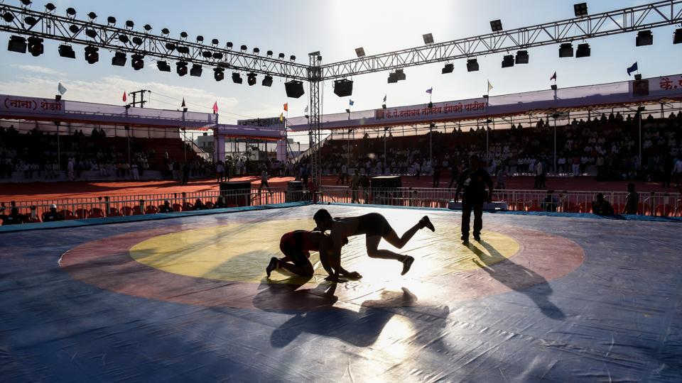 Two wrestlers fight it out on the mat category of the state-level competition. (Sanket Wankhade/HT PHOTO)