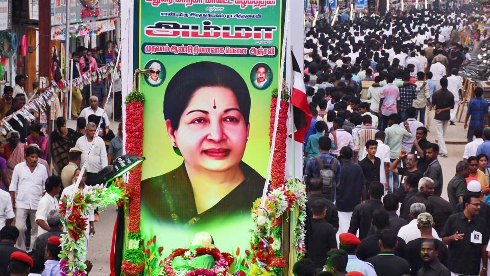 AIADMK supporters stage a 'silent rally' to observe the first death anniversary of J Jayalalithaa at West Masi Street in Madurai on Tuesday. A purported video of Jayalalithaa has been released by one P Vetrivel, who claims to be a supporter of Sasikala's nephew TTV Dhinakaran. HTcouldn't independently verify the authenticity of the video.