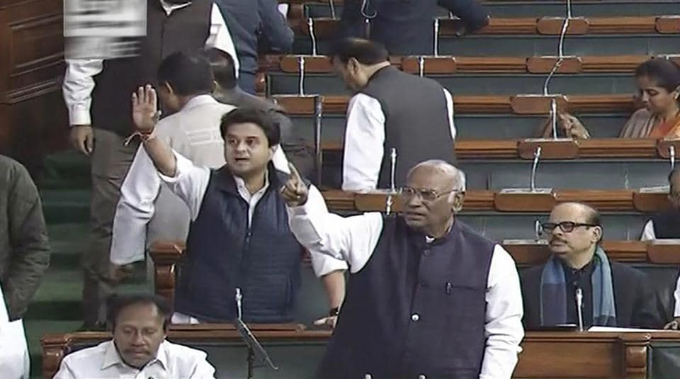 Congress members Mallikarjun Kharge, Jyotiraditya Scindia and others protest in the Lok Sabha on Wednesday, during the ongoing winter session of Parliament. (PTI Photo / TV GRAB)