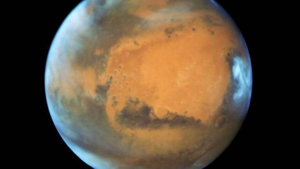 The planet Mars is shown May 12, 2016 in this NASA Hubble Space Telescope view taken May 12, 2016 when it was 50 million miles from Earth. NASA/Handout via Reuters/Files