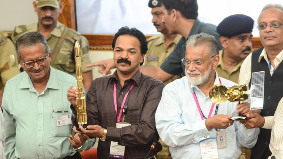 A file photo of former ISRO Chairman Dr K Radhakrishnan (in white shirt) with other scientists after the PSLV C25 launch for the Mars mission, in Sriharikota, India in 2013.