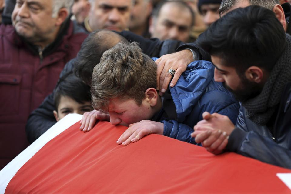 Family and friends mourn on January 1, 2017, during the funeral for Ayhan Akin, a victim of a shooting at a nightclub in Istanbul.