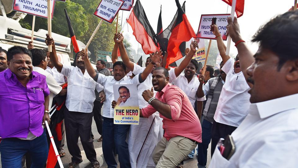 Supporters of  DMK leader and former telecom minister A Raja celebrate in Delhi after a special court on December 21 acquitted him in the 2G spectrum case.