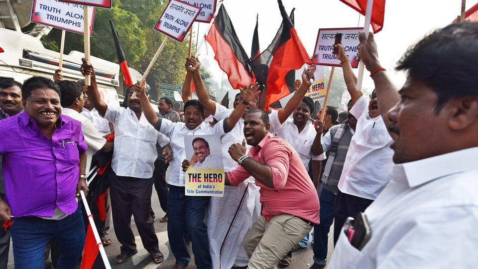 Supporters of former telecom minister A Raja celebrate after his acquittal in 2G spectrum case, in New Delhi.