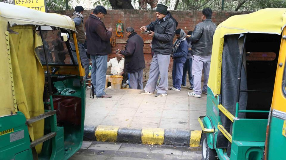 Auto rickshaw drivers at Ram Hazoor's dal-chawal stall on Kasturba Gandhi Marg.