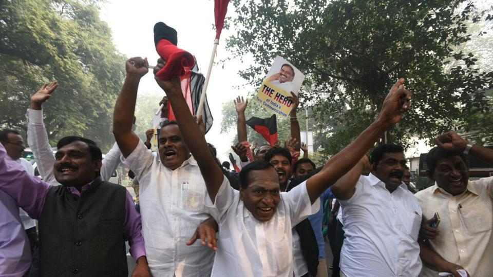 DMK supporters celebrate outside the Patiala House court in New Delhi on Thursday.