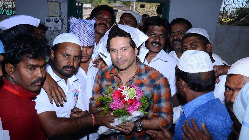"""Sachin Tendulkar during his visit to Donja village in Osmanabad, Maharashtra on December 19. The cricket legend and Rajya Sabha MP adopted Donja under the Sansad Adarsh Gram Yojana. Tendulkar was to debate on """"Right to Play and the future of sports in India"""" in the Upper House on Thursday, but the same was stalled after another adjournment of the house."""