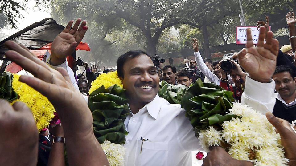 Former telecom minister A Raja celebrates along with his supporters after he was acquitted by a special court in the 2G scam case, in New Delhi.