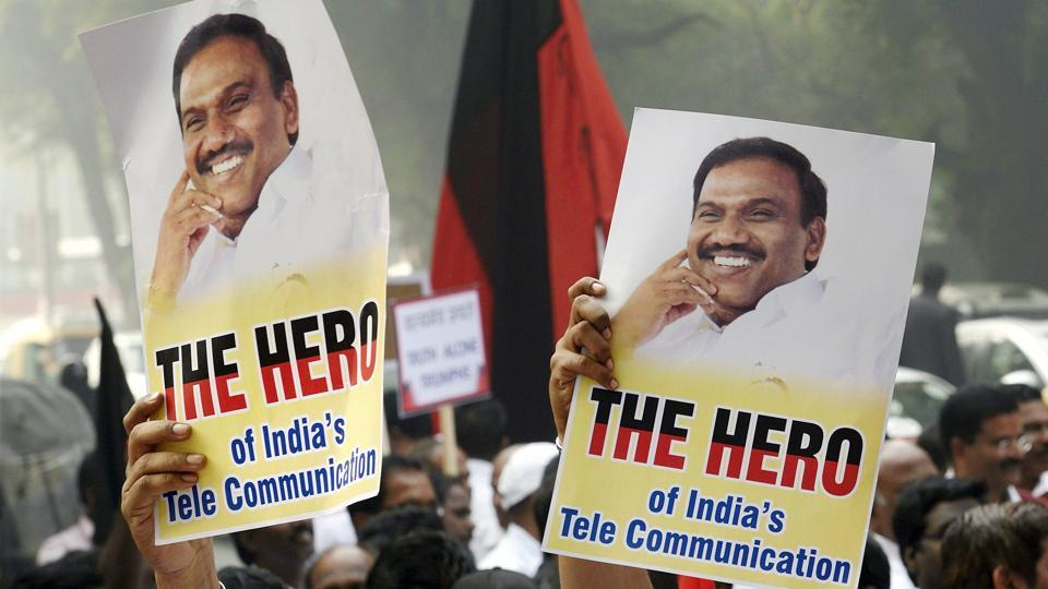 Former telecom minister A Raja's supporters celebrate his acquittal by a special court in the 2G scam case, in New Delhi.