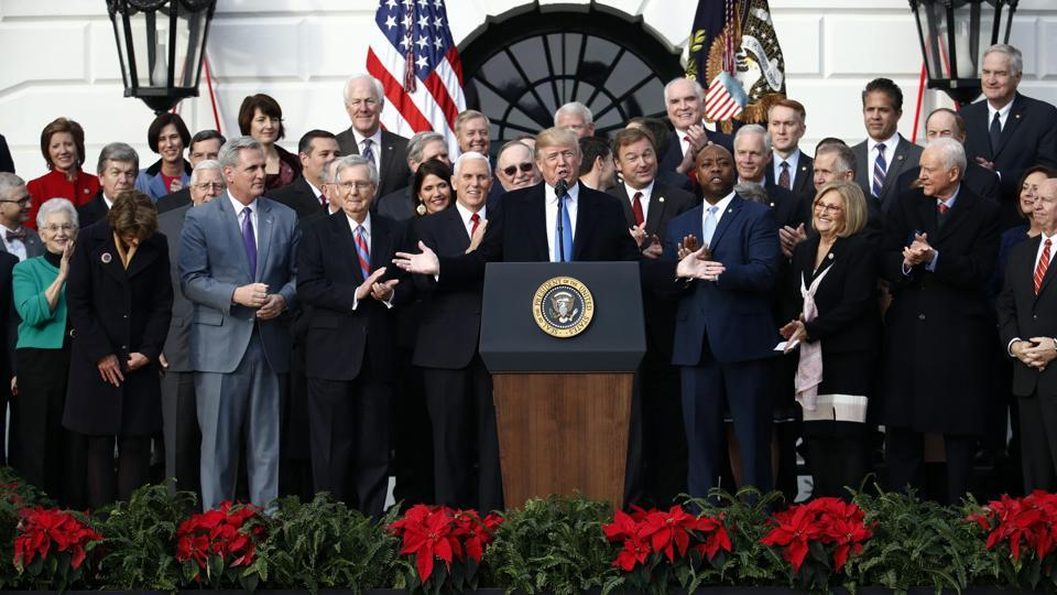 President Donald Trump speaks during a bill passage event on the South Lawn of the White House in Washington, Wednesday, Dec. 20, 2017, to acknowledge the final passage of tax overhaul legislation by Congress.