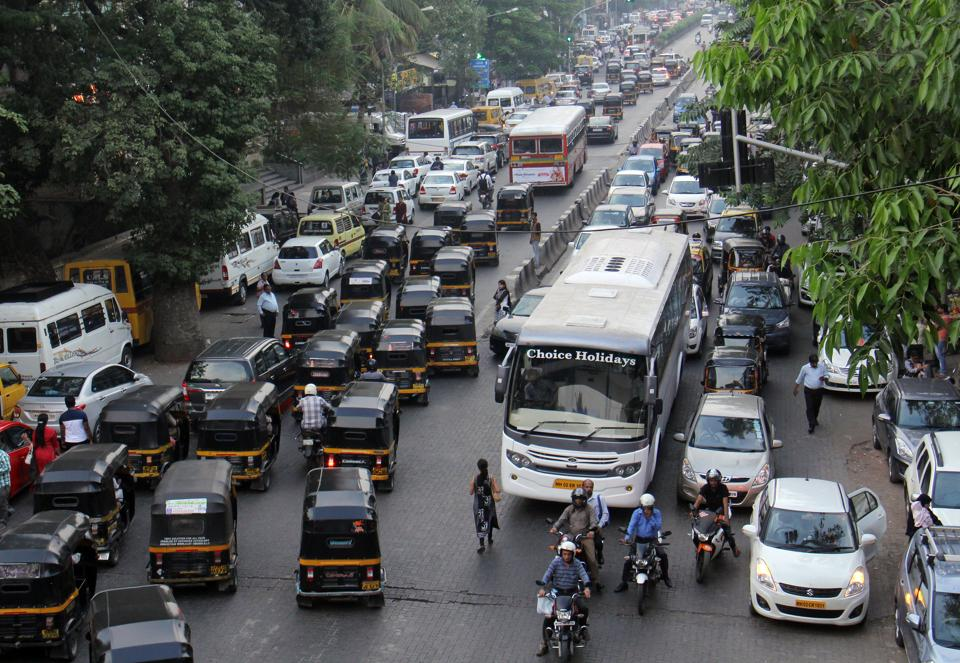With buses occupying SVRoad, other vehicles are forced to double park.