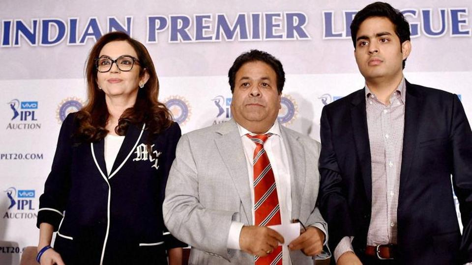 Indian Premier League chairman Rajeev Shukla (C) with Mumbai Indians owner Neeta Ambani (L) and her son Akash at a press meet.