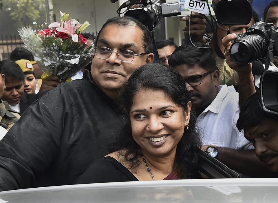 DMK MP Kanimozhi and her husband G Aravindan celebrate in Delhi after the politician  was acquitted by a special court in the 2G scam case in Delhi on December 21.