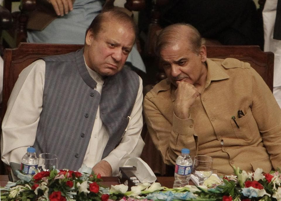 Former Pakistani prime minister Nawaz Sharif (left) and his brother Shehbaz Sharif in on October 4, 2017.