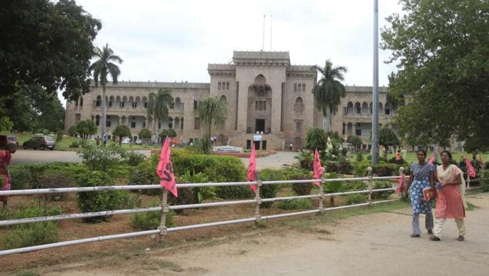 Students walks in front of the Arts college at Osmania University in Hyderabad. (Mint Photo)