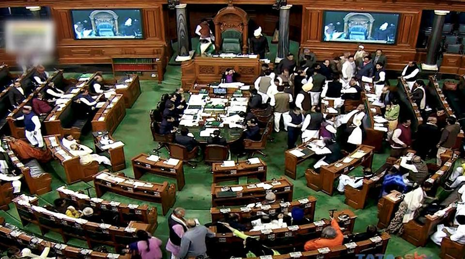 Congress members disrupt the proceedings in Lok Sabha in New Delhi during the ongoing winter session of Parliament.