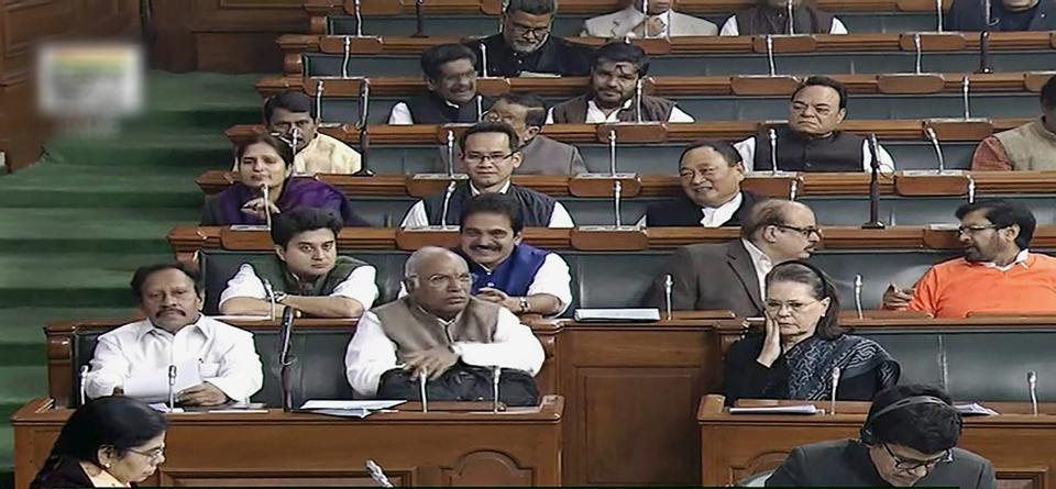 Congress leaders Mallikarjun Kharge and Sonia Gandhi inside the Lok Sabha in New Delhi on Thursday during the ongoing winter session of Parliament.