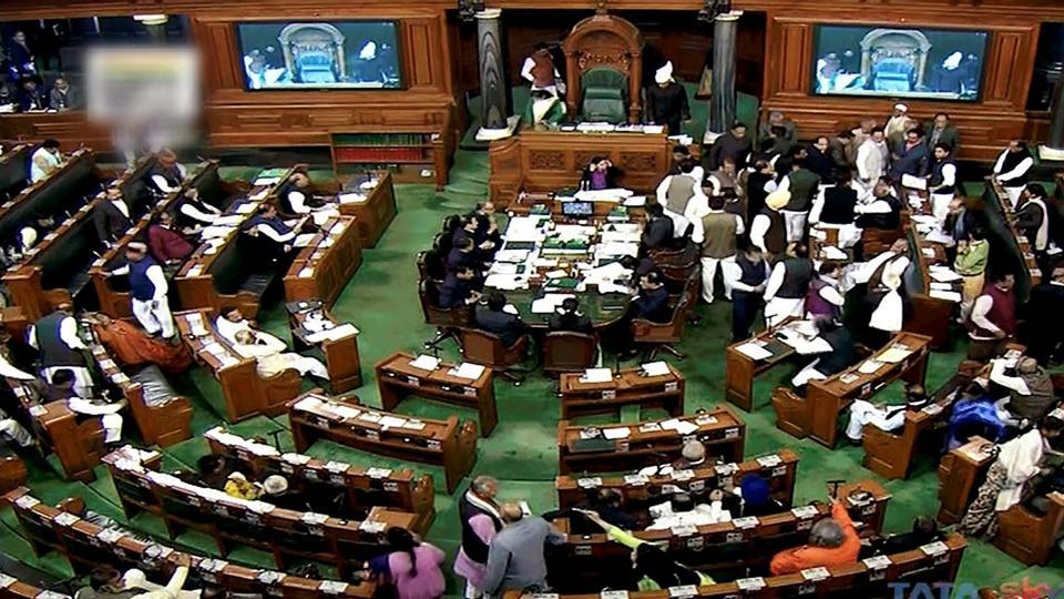 Congress members disrupt the proceedings in the Lok Sabha in New Delhi on Wednesday, during the ongoing winter session of Parliament.