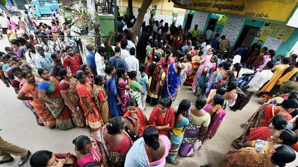 Voters wait in long queues to cast their votes for the RK Nagar assembly bypoll in Chennai on Thursday.