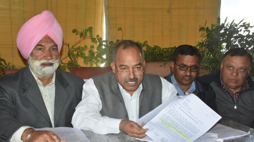 Raghunath Singh Negi (2nd from left) addresses a press conference in Dehradun on Thursday.