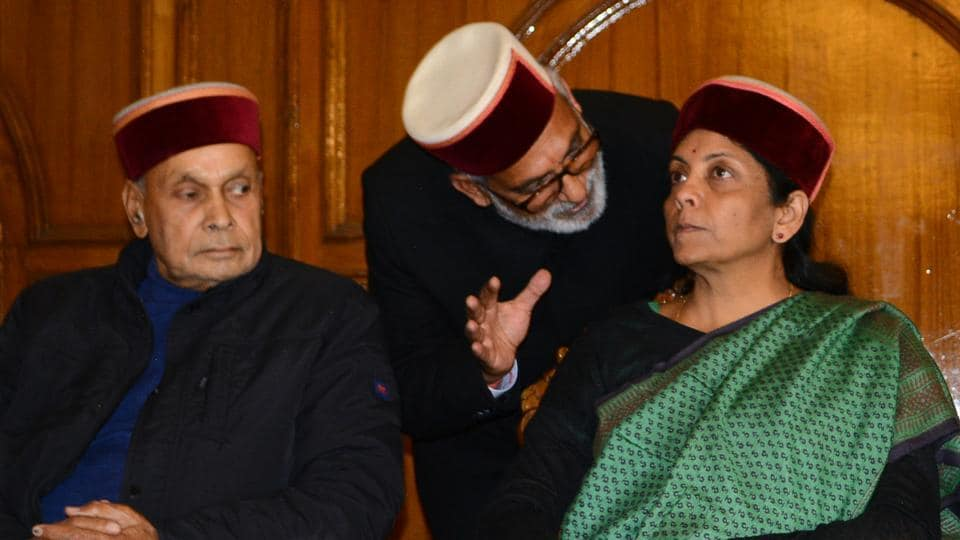 Defence minister Nirmala Sitharaman (right), former chief minister Prem Kumar Dhumal (left) and BJP leader Chander Mohan Thakur at a meeting in Shimla on Thursday.