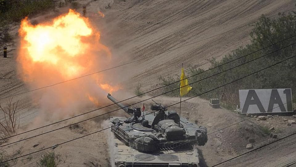 A South Korean tank of the 8th Mechanized Infantry Division takes part in a live-fire exercise at a training ground in Cheorwon, near the demilitarized zone (DMZ).