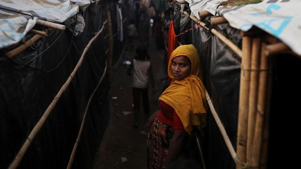 A Rohingya refugee woman stands by her temporary settlement at the Shamlapur refugee camp near Cox's Bazar, Bangladesh December 20, 2017.