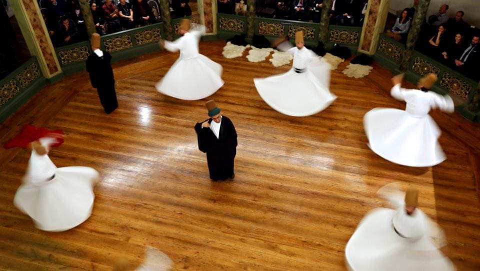 "The audience watched entranced at a dance which copies the movement of planets against a background of Sufi music. ""When we say Konya, we think of Mevlana and when we say Mevlana, Konya comes to mind,"" Abdussettar Yarar, director of Konya Culture and Tourism said. (Murad Sezer / REUTERS)"