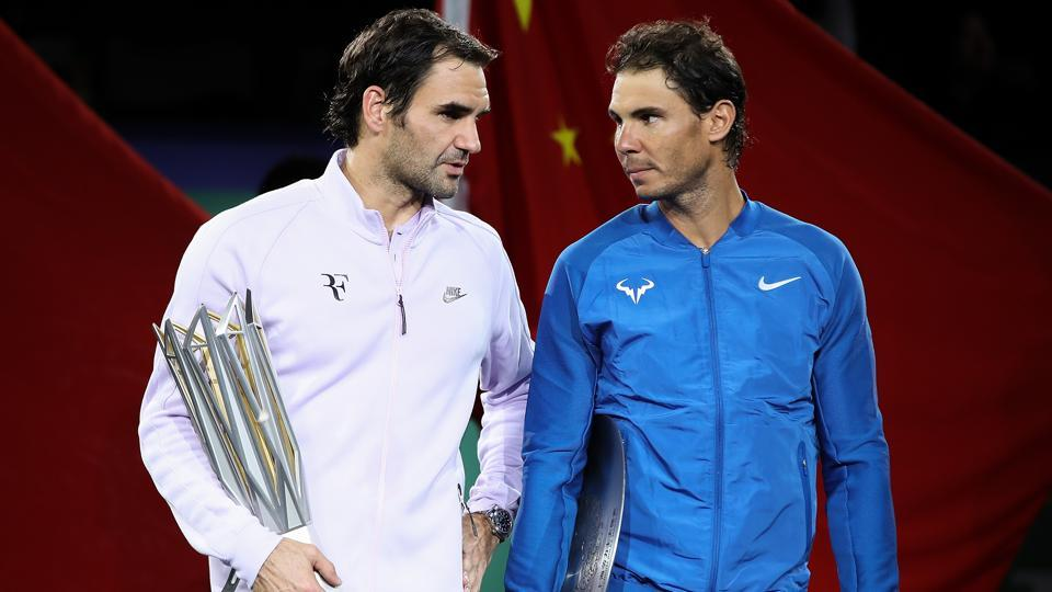 Roger Federer of Switzerland with Rafael Nadal of Spain pose with their trophies after the Men's singles final mach on day eight of 2017 ATP Shanghai Rolex Masters at Qizhong Stadium on October 15, 2017 in Shanghai.