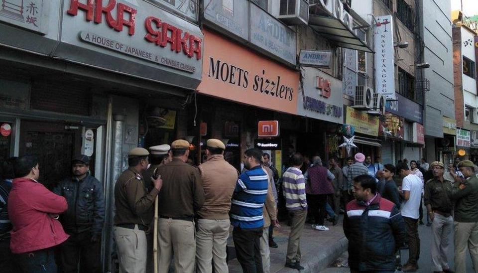 Delhi Police personnel enforcing sealing drive in Defence Colony.
