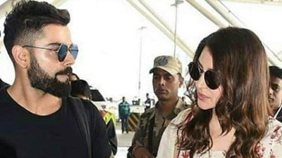 Virat Kohli and Anushka Sharma as they leave for Mumbai after their wedding reception in Delhi.