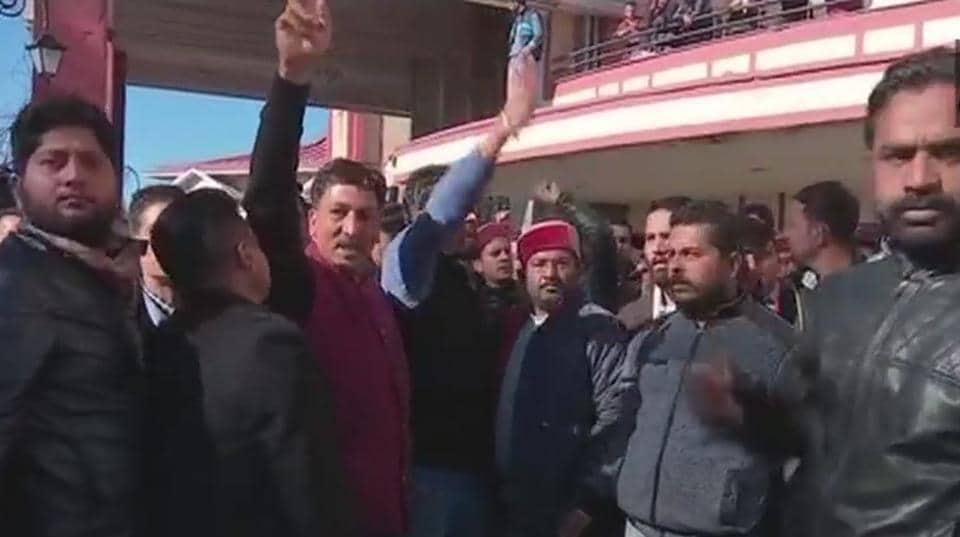 Supporters of Prem Kumar Dhumal raise slogans in his favour outside the venue of the core committee meeting in Shimla on Friday.