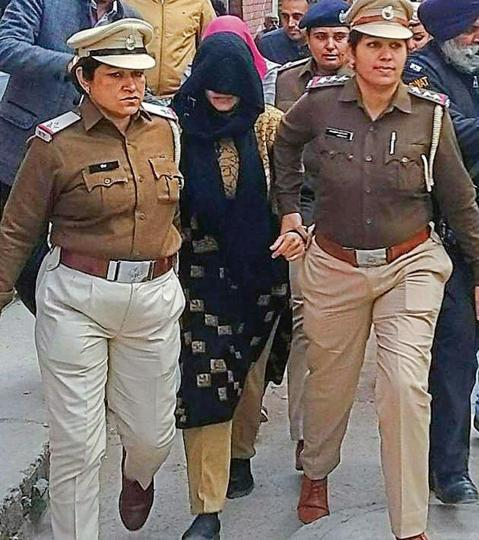 Honeypreet, the adopted daughter of the dera head, being taken to court in Panchkula Panchkula on Thursday.