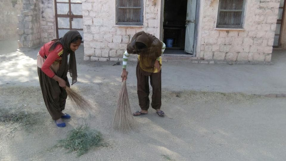 Students sweep the premises of Government Senior Secondary School in Bharatpur's Jeevad.